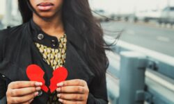 Woman sick and tired of getting heart broken. Protect your heart with these simple steps.